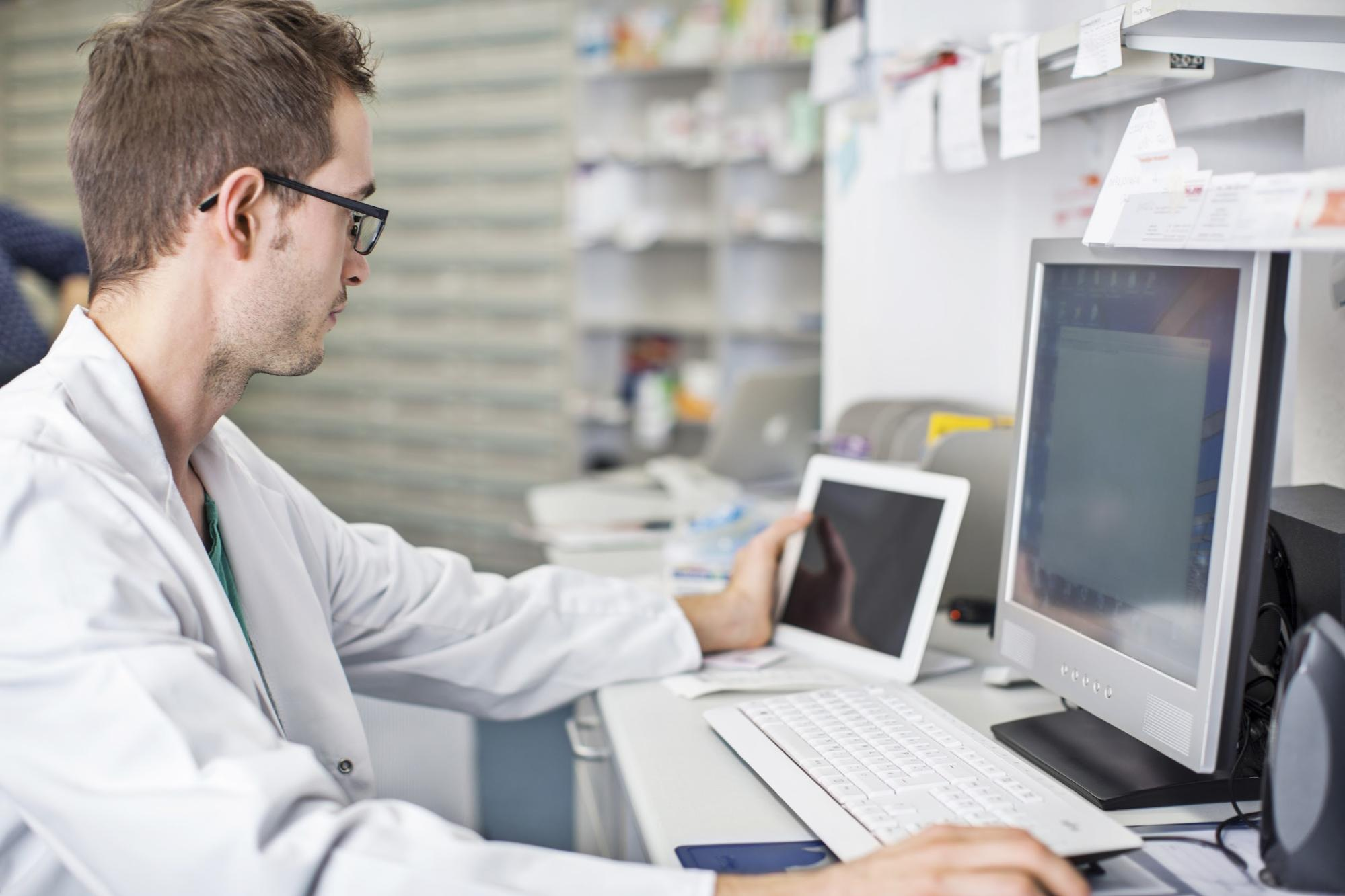 Pharmacist working at a computer